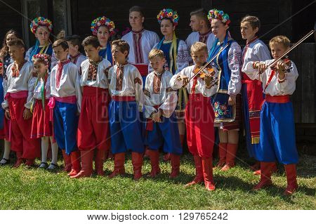 ROMANIA TIMISOARA - JULY 12 2015: Unidentified young Ukrainians in traditional costume present at a international folk festivalduring