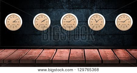 Five orange clock against wooden background