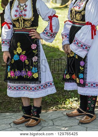 Young girls from Serbia in traditional specific costumes attended at a international folk dance festival