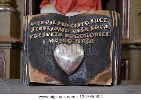 SVETI MARTIN POD OKICEM, CROATIA - SEPTEMBER 16: Immaculate Heart of Mary on the altar of the Virgin Mary in the church of Saint Martin in Sv. Martin pod Okicem, Croatia on September 16, 2015.
