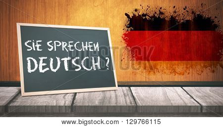 sie sprechen deutsch against germany flag in grunge effect