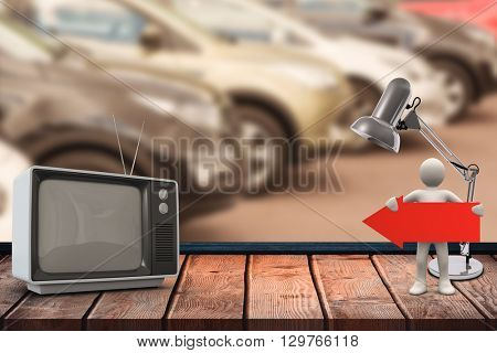 An old TV against view of row new car