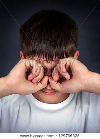 Young Man Rub the Eyes on the Dark Background