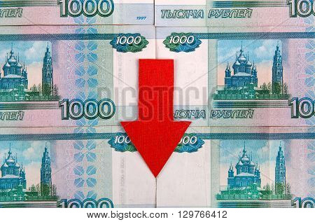 Russian Rubles and Red Arrow Down closeup