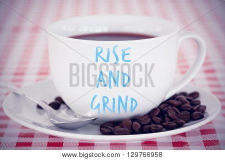 rise and grind against coffee and beans on a tablecloth