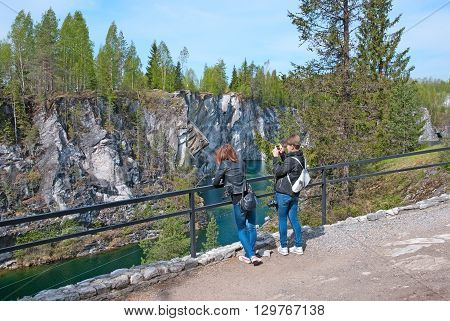 RUSKEALA, KARELIA, RUSSIA - MAY 14, 2016: People take pictures in The Mountain Park