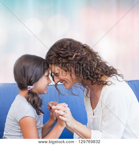 Colored background against happy mother and daughter smiling at each other
