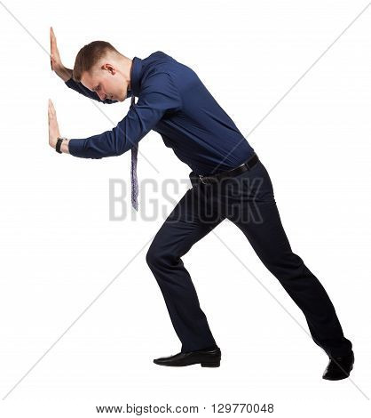 Young Businessman trying to push barrier, conceptual photo, isolated on white background.