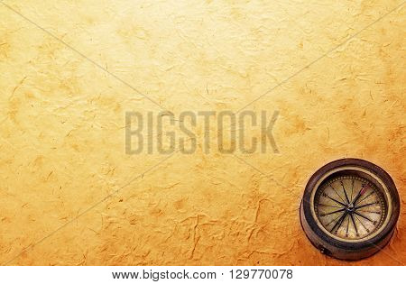 Ancient Brass Compass On Vintage Old Paper Background. Retro Stale.