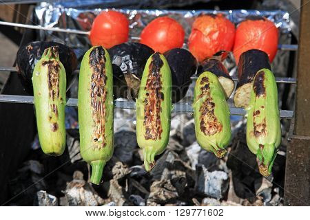 Vegetables on the grill over low heat for preparing