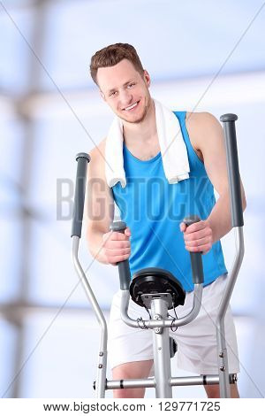 Sport man doing healthy Fitness with a Exercise Machine