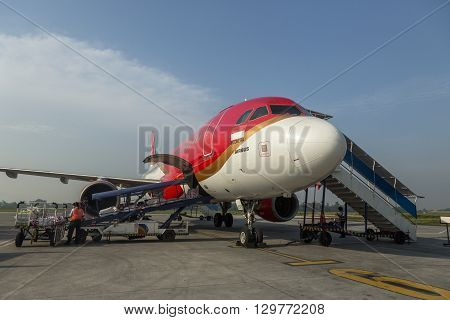 YOGYAKARTA INDONESIA - MARH 20 2016 Air Asia at Yogyakarta Airport. Air Asia company is the largest low cost airlines in Asia