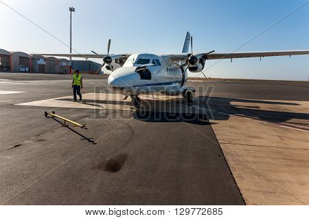 SAO VICENTE, CAPE VERDE - DECEMBER 12, 2015: Small local propeller powered passenger aircraft Cesaria Evora Airport. Cabo Verde Africa