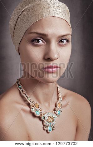 girl in turban on the black background