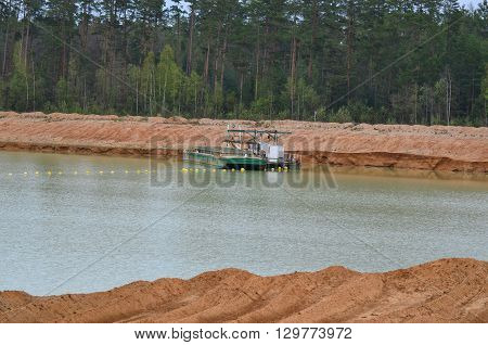 sand extraction suction boat in the sand quarry II Cep South Bohemia Czech Republic
