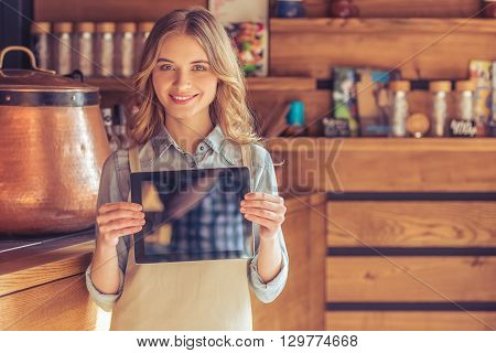 Beautiful Young Waitress With Gadget
