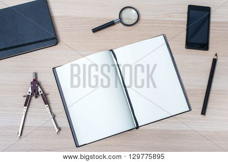 Workplace Top View. Notebook On Wooden Table