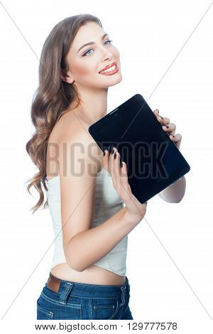 Woman with smile in hands holds a tablet computer.