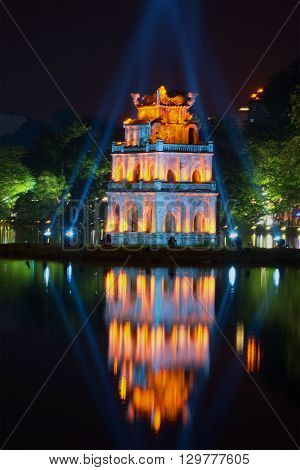 The Turtle tower on Hoan Kiem lake in the spotlight close-up. Hanoi, Vietnam