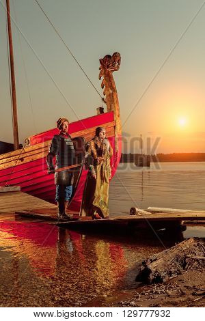 North Princess And Warrior With Sword On The Sailing Ships Background.