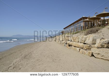 MARBELLA, SPAIN -APRIL 9, 2016: Bar over rocks in the beach of Marbella a city in southern Spain belonging to the province of Malaga Andalusia Spain