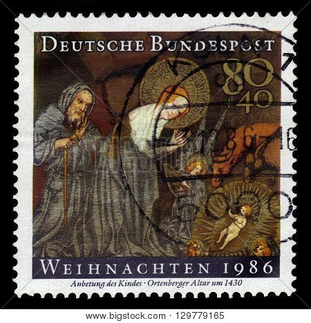 GERMANY - CIRCA 1986: a stamp printed in Germany shows adoration of the Child, left wing of Ortenberger altar by anonymous german painter, circa 1986