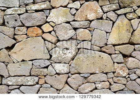Ancient wall of stones built with blocks of Trachyte and Tuff. Texture