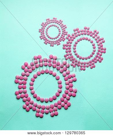Creative medicine and healthcare concept made of drugs and pills, in the shape of gears.