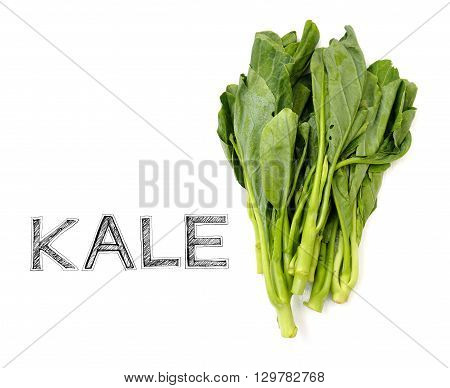 Kale vegetable Raw material for cook on white wood chair photo isolate in my kitchen and have design my font free hand word.
