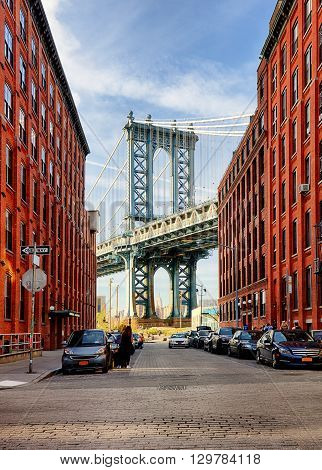 Manhattan Bridge from an alley in Brooklyn New York