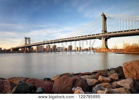 Manhattan Bridge over East River at sunset in New York City Manhattan.