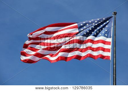 Majestic United States Flag with blue sky