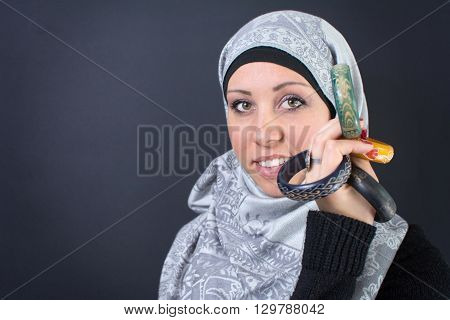 Beautiful young muslim woman in hijab with jewelry