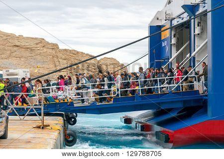 Santorini, Greece - May 2, 2016: The big sea ferry is moored off in the port of Athinios on the island of Santorini. Sea ferries make regular flights between the Greek islands.