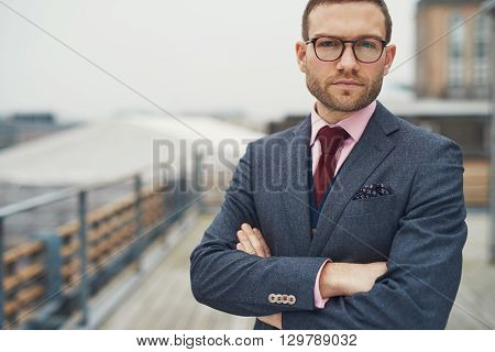 Stylish Businessman Standing Outside Near Railing