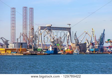 GDYNIA, POLAND - APRIL 22: View of the shipyard and 1000-ton Gantry Crane in Shipyard, on April 22, 2015 in Gdynia, Poland. One of the largest in Europe Gantry Cranes with dimensions of 106 m high, 153 m wide.