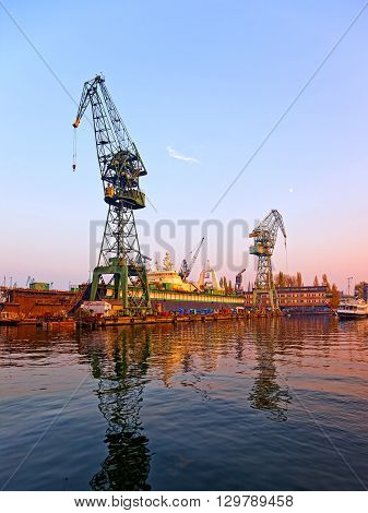 View of the industrial zone. Cranes docks in shipyard.