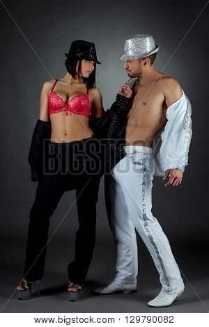 Striptease show. Image of passionate couple poses at camera