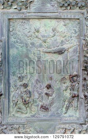 PISA, ITALY - JUNE 06, 2015: Adoration of the Shepherds, detail of the bronze door to the left of the Cathedral St. Mary of the Assumption in Pisa, Italy on June 06, 2015
