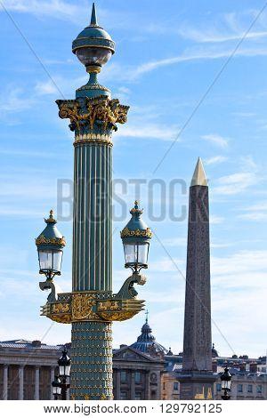 Paris Place de la Concorde a street lamp and the Egyptian obelisk.