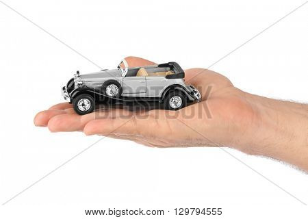 Hand with retro car isolated on white background