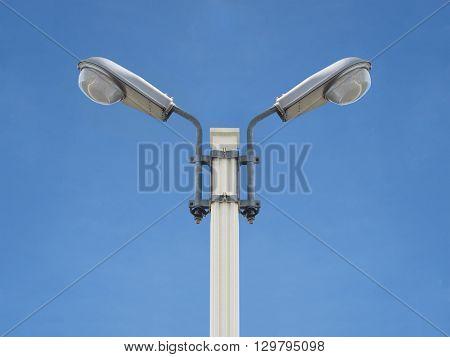 street light public infrastructure against clear blue sky