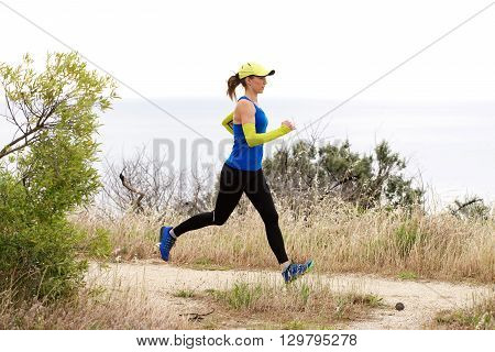 Sporty Woman Running On Dirt Path