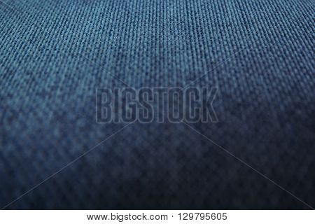Chess texture fluffy cloth. Dark blue background. Fabric background.