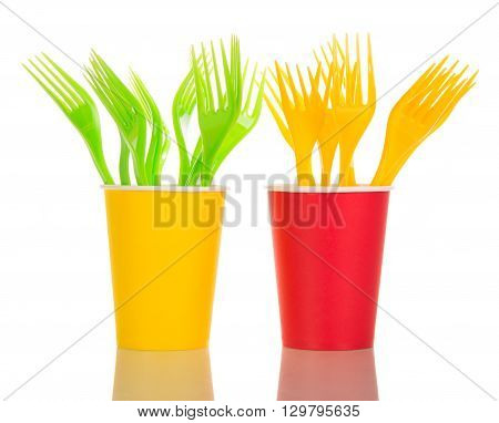 Multi-colored disposable cups and forks isolated on white background.