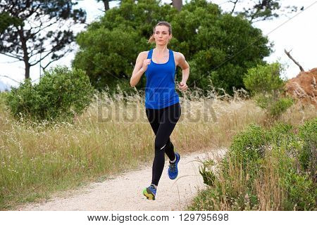 Older Woman Jogging In Countryside