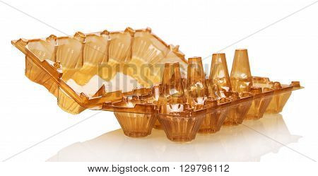 Empty plastic box for eggs isolated on white background.