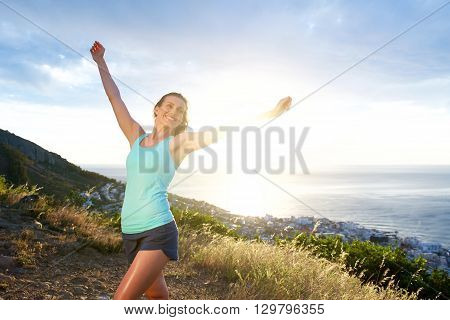 Smiling Athletic Woman With Arms Outstretched