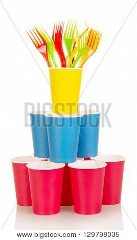 Pyramid from multi-colored disposable cups and plastic forks isolated on white background.