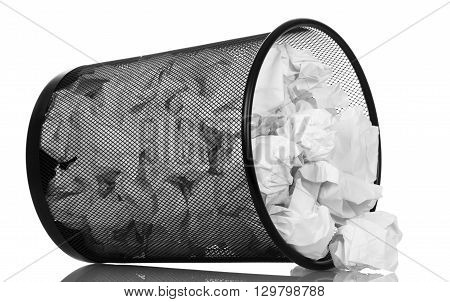 tipped metal bucket with paper waste isolated on white background.